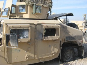 After the IED: Humvee after being struck by an explosively formed penetrator (EFP).