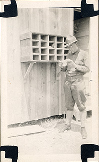 Lawrence took this photo of a fellow soldier, R.E. Mauger, reading mail from home while training at Fort Sheridan.