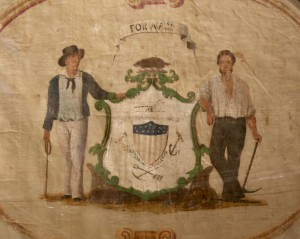 The seal painted on the reverse makes this one of the earliest known flags still in existence to bear the Seal of Wisconsin.